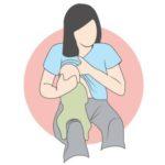 bébé tète à califourchon